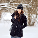 Portrait of a young beautiful woman in snowy weather.  Stock Photo
