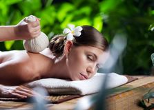 Portrait of young beautiful woman in spa environment.  royalty free stock photography