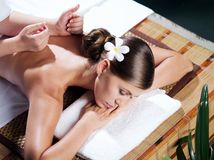 Spa massage. Portrait of young beautiful woman in spa environment Royalty Free Stock Images