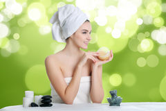 Portrait of young beautiful woman in spa environment. Young spa woman touching her face after beauty treatment Royalty Free Stock Photo