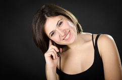 Portrait of young beautiful woman speaking on  phone Royalty Free Stock Image