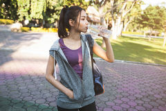 Portrait of young beautiful woman in sport wearing drinking wate Stock Photo