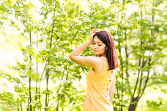 Portrait of young beautiful woman in spring blossom trees Royalty Free Stock Photo