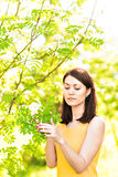 Portrait of young beautiful woman in spring blossom trees royalty free stock photography