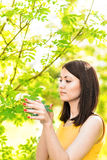 Portrait of young beautiful woman in spring blossom trees royalty free stock photos
