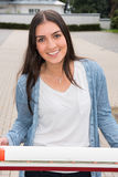 Portrait of a young beautiful woman standing outside at a barrie Stock Images
