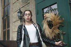 Portrait of a young beautiful woman on street, model posing, women`s urban street fashion stock photos