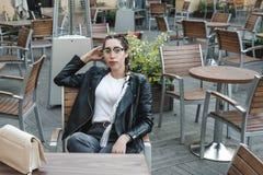 Portrait of a young beautiful woman on street, model posing, women`s urban street fashion stock photo