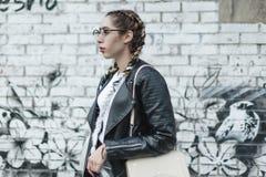 Portrait of a young beautiful woman on street, model posing, women`s urban street fashion royalty free stock photos