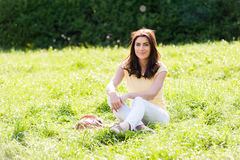 Portrait of young beautiful woman in summer city park. Stock Photography