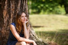 Portrait of young beautiful woman in summer forest royalty free stock images
