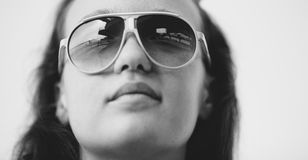 Portrait of a young beautiful woman with sun glasses Royalty Free Stock Images