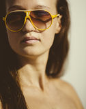 Portrait of a young beautiful woman with sun glasses Stock Photography