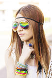 Portrait of young beautiful woman with sunglasses hippie style. Stock Photos