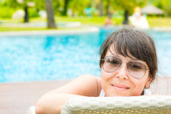 Portrait of a young beautiful woman with sunglasses Royalty Free Stock Images