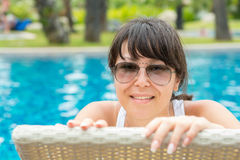 Portrait of a young beautiful woman with sunglasses lying Stock Photo