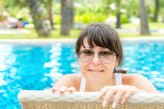 Portrait of a young beautiful woman with sunglasses lying  Stock Photos