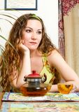 Portrait of young beautiful woman with tea Royalty Free Stock Image