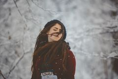 Portrait Young beautiful woman throws snow royalty free stock photos