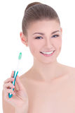 Portrait of young beautiful woman with tooth brush isolated on w Stock Image
