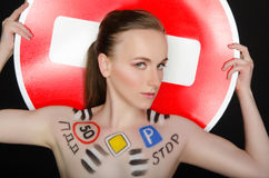 Portrait of young beautiful woman with traffic signs Royalty Free Stock Photography