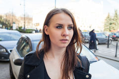 Portrait of young beautiful woman. Urban style. Stock Photos
