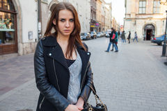 Portrait of young beautiful woman. Urban style. Negative emotion Stock Photo