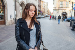 Portrait of young beautiful woman. Urban style. Negative emotion Stock Image