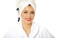 Portrait of young beautiful woman wearing bathrobe Royalty Free Stock Photos
