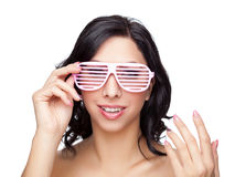 Portrait of an young beautiful woman wearing cool glasses Royalty Free Stock Image