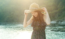 Portrait of young beautiful woman wearing long dress and wide st Royalty Free Stock Photography