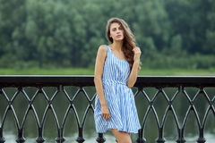 Portrait young beautiful woman in white blue striped dress, summer rver park outdoors Stock Image
