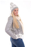 Portrait of young beautiful woman in winter clothes posing isola Royalty Free Stock Photo