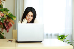 Portrait of a young beautiful woman working on a laptop Stock Photography