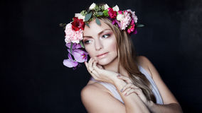 Portrait  young beautiful woman in wreath of Royalty Free Stock Images