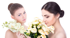 Portrait of young beautiful women with flowers  on white Royalty Free Stock Photos