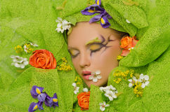 Portrait of young beautiful women in flowers Royalty Free Stock Images