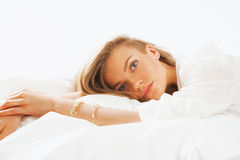 Portrait of young beautifulwoman waking up in the morning on the Stock Image
