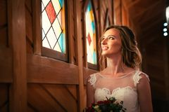 Portrait young beauty bride near the window royalty free stock image