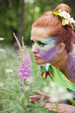 Portrait of young beauty with butterflies outdoors stock photography