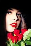 Portrait of Young Beauty Female with Red Roses Royalty Free Stock Photo