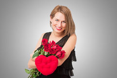 Portrait of a young beauty with rose heart Royalty Free Stock Photography
