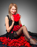 Portrait of a young beauty with rose heart Royalty Free Stock Photo