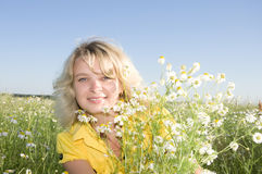 Portrait of young beauty woman with camomile Royalty Free Stock Images