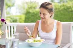 Portrait of young beauty woman eating salad Royalty Free Stock Image