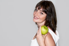 Portrait of young beauty woman with green apple Stock Photography