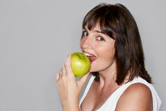 Portrait of young beauty woman with green apple Stock Image