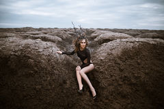 Portrait of young beauty woman with wooden crown. Alien landscape Royalty Free Stock Photo