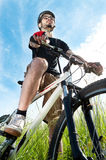 Portrait of a young biker in the field Royalty Free Stock Photos