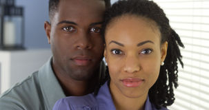 Portrait of young black couple looking at camera Stock Image